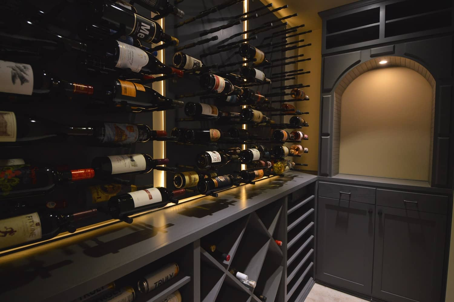A combination of wine pegs, diamonds bins and wine shelf gives a nice aesthetic appeal to the overall ensemble of the wine cellar.