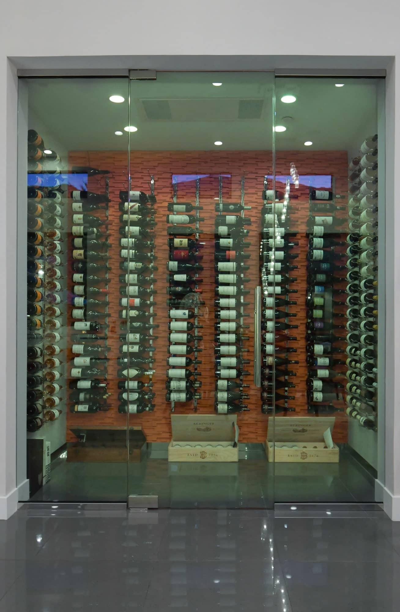 Color of LED for this wine cellar is adjustable. For this one, the lighting was set to subtle green.