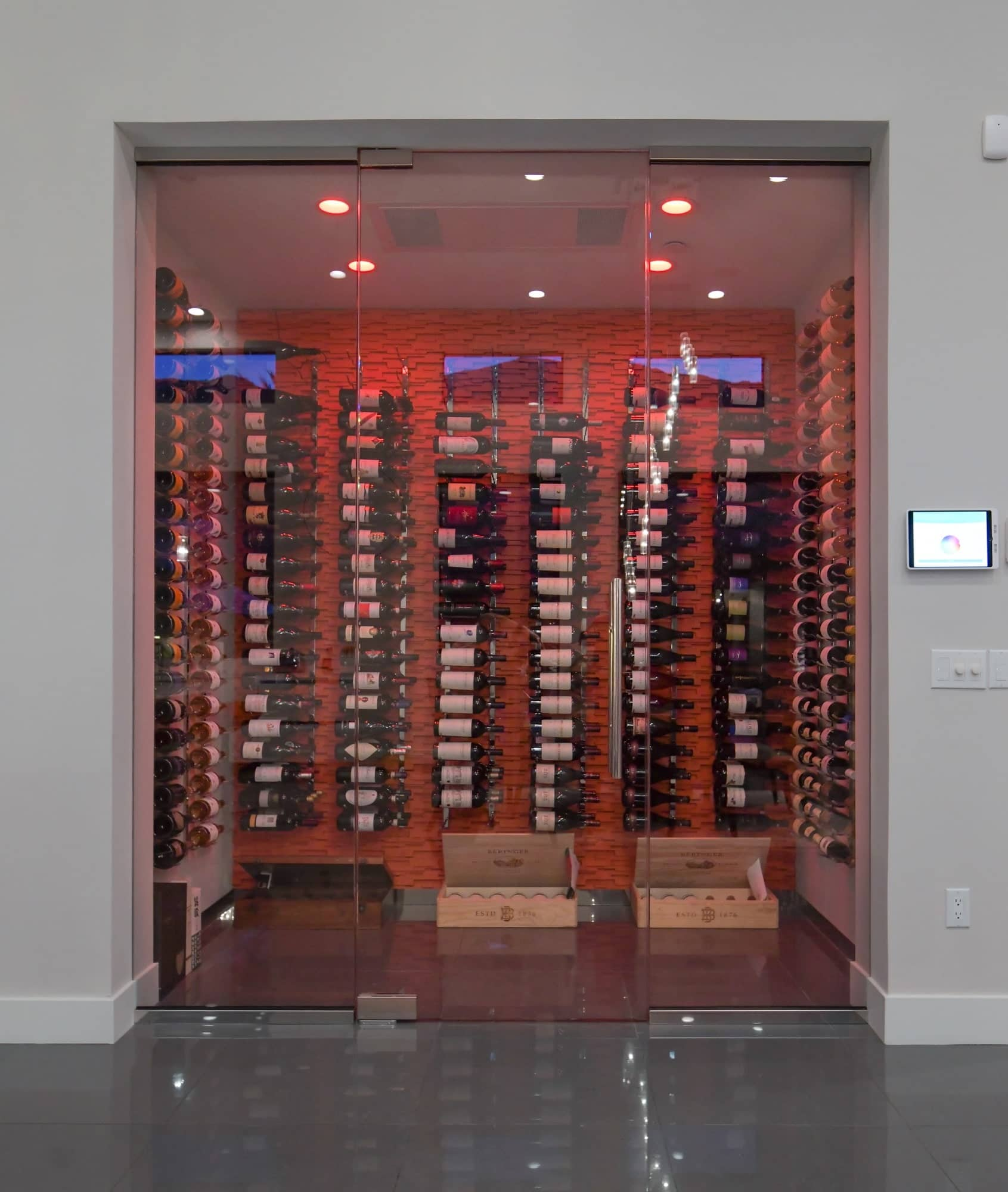 Color of LED lighting is adjustable in this wine cellar For this one lighting was to red