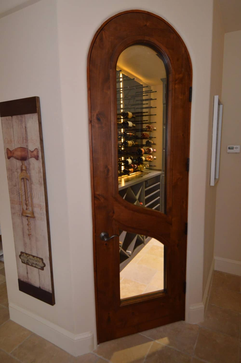 From outside you can see the interior of the wine cellar because of the glass panels embedded in the door.