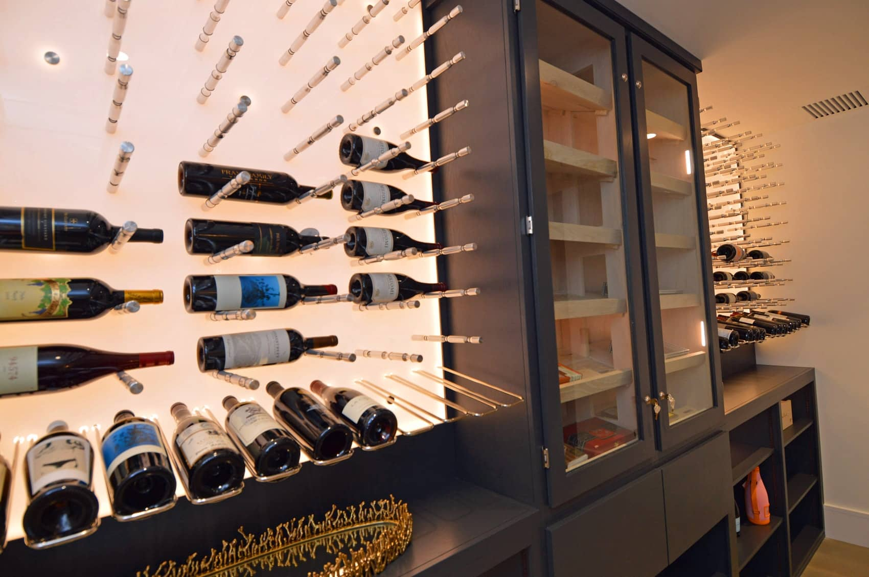 LED bulbs behind the white acrylic panel gives a subtle illumination for the wine pegs.