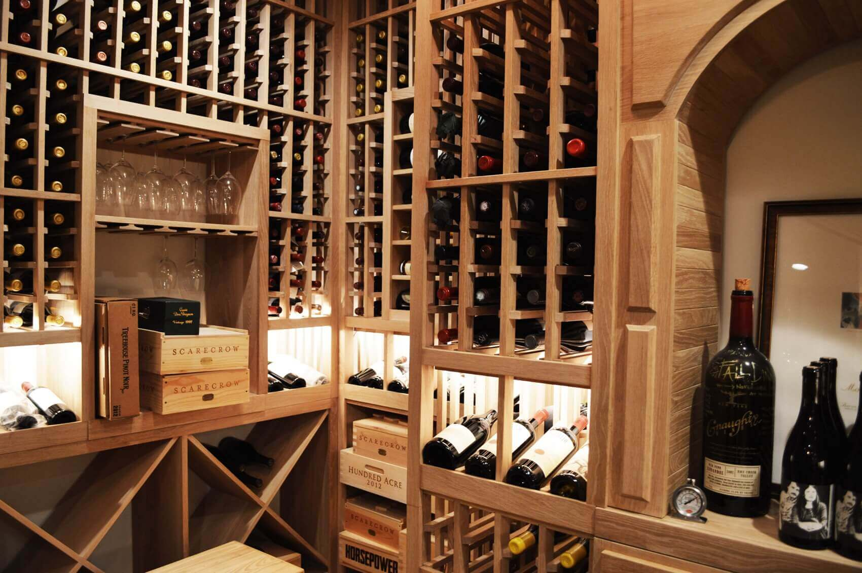 LED lighting was stragetically placed to highlight the client's favorite and most priced wines among his collection.