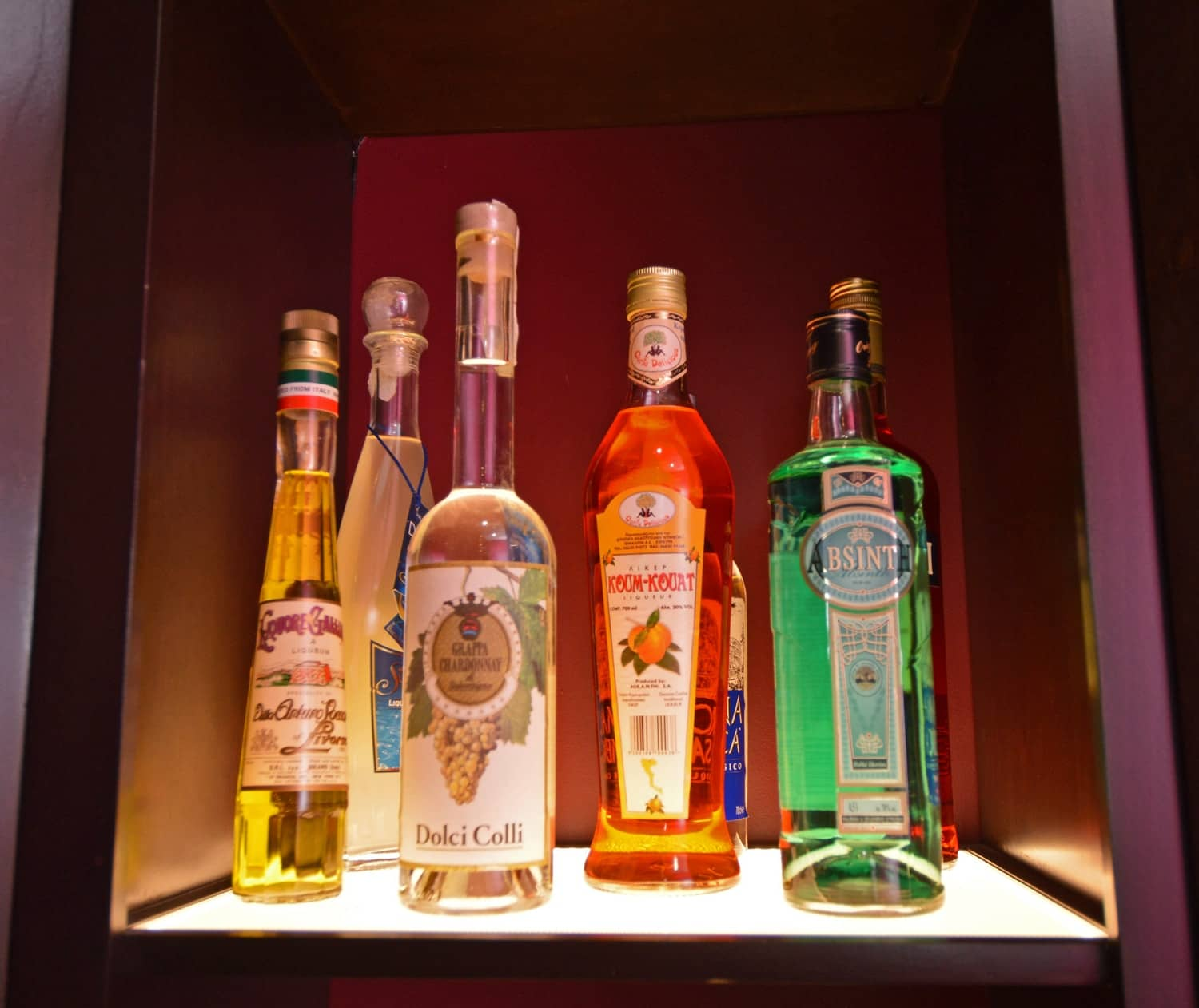 Lighting underneath the liquor shelf adds more emphasis to spirits placed there.