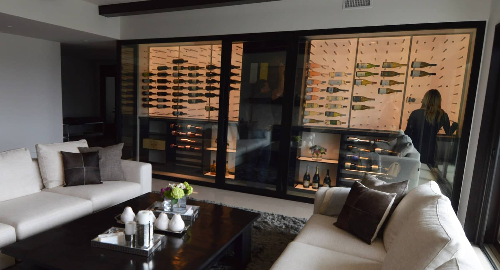 Mellow wine cellar lighting coming from the white backpanel radiates that romantic vibe. A perfect scene for a dinner date with your spouse or your friends and family.