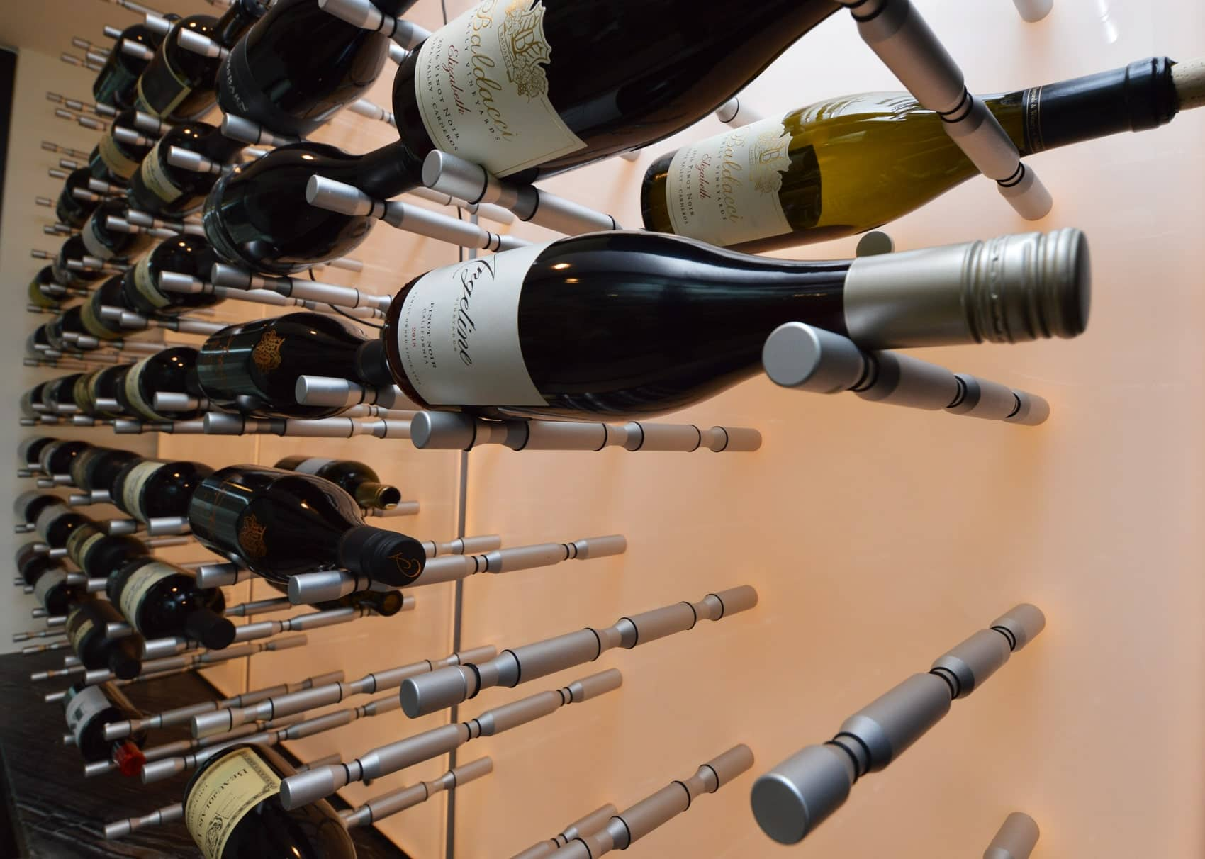 Rubber rings on the wine pegs prevents movement of wine bottles when placed on top of it.