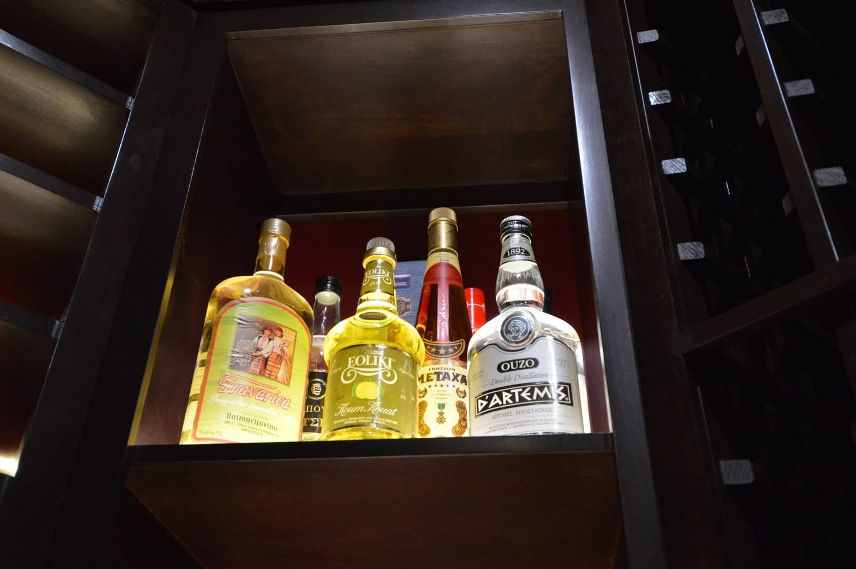 Spirits in the lighted cubicle appears glowing when viewed underneath the shelf.