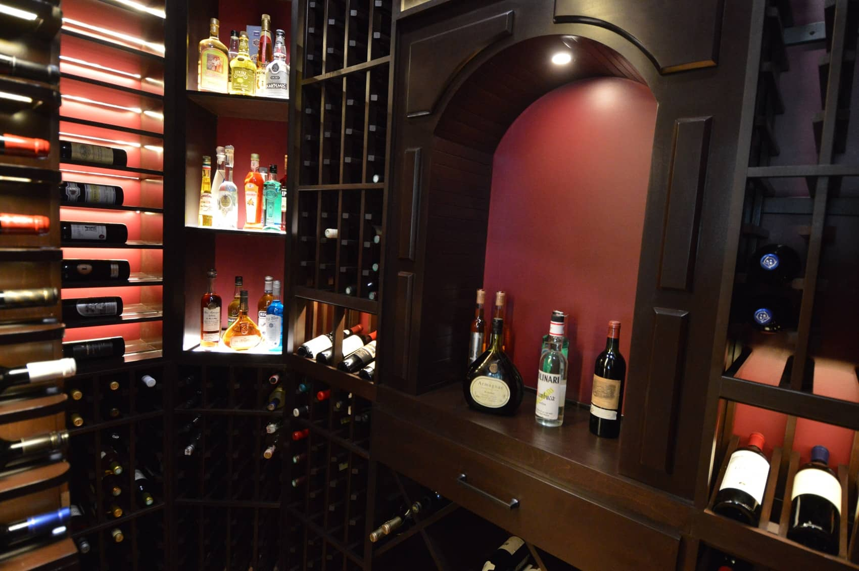 Steve's team created a custom wine cellar arch to house more spirts. Alternately, the area could also be use for decantation of wines.