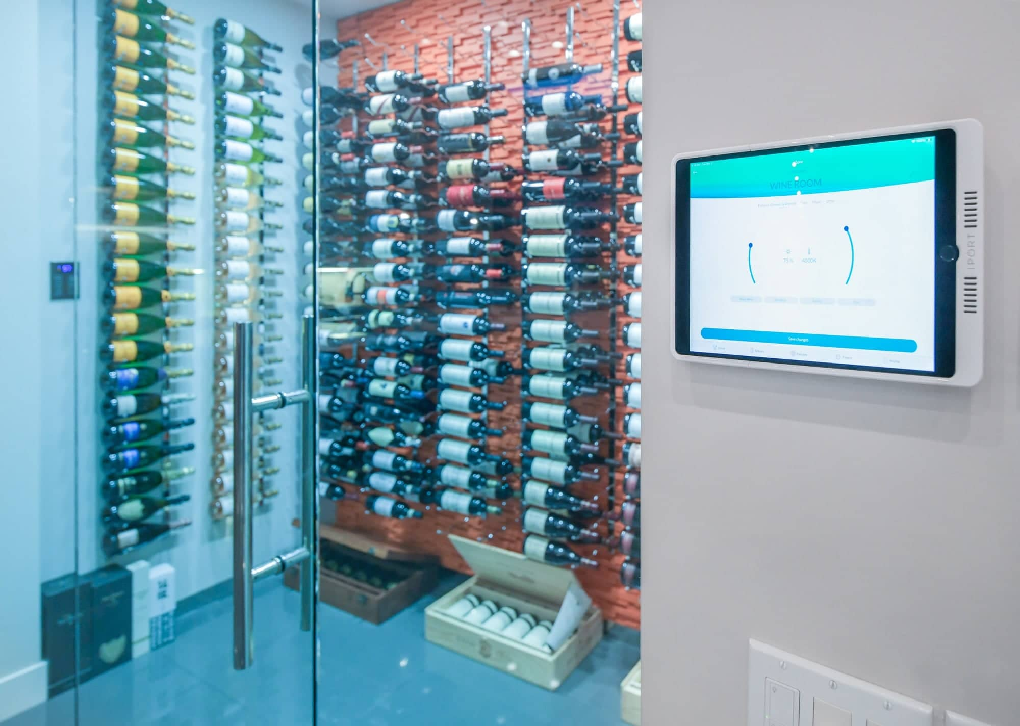 The ability to change the color of the LED lighting is one of the innovative features for this wine cellar. For this photo, the lighting was set to bluish green.