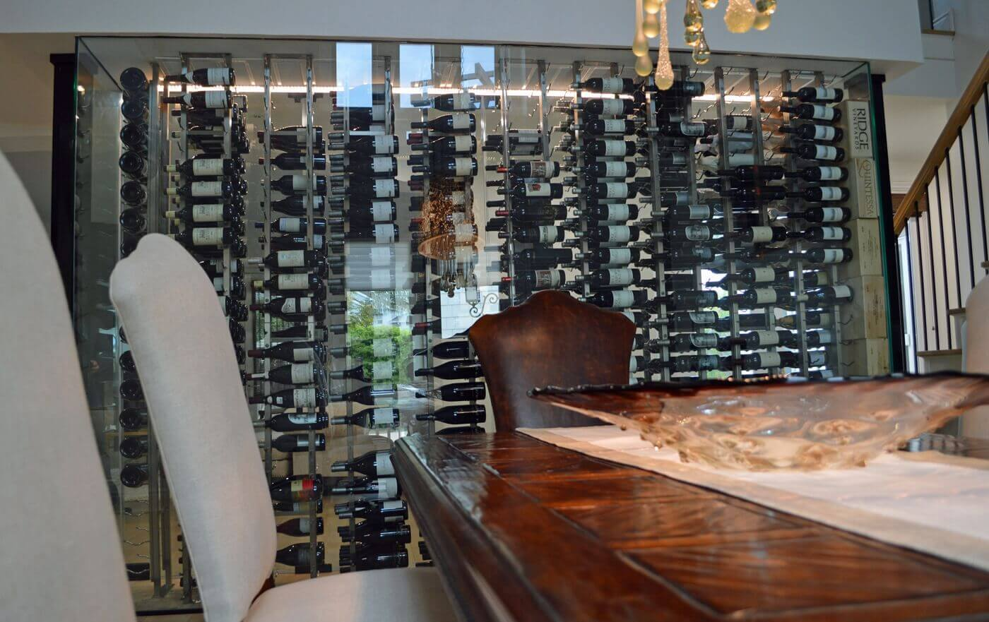 The contemporary design of the glass enclosed wine cellar blends well with the modern interior design of the home.