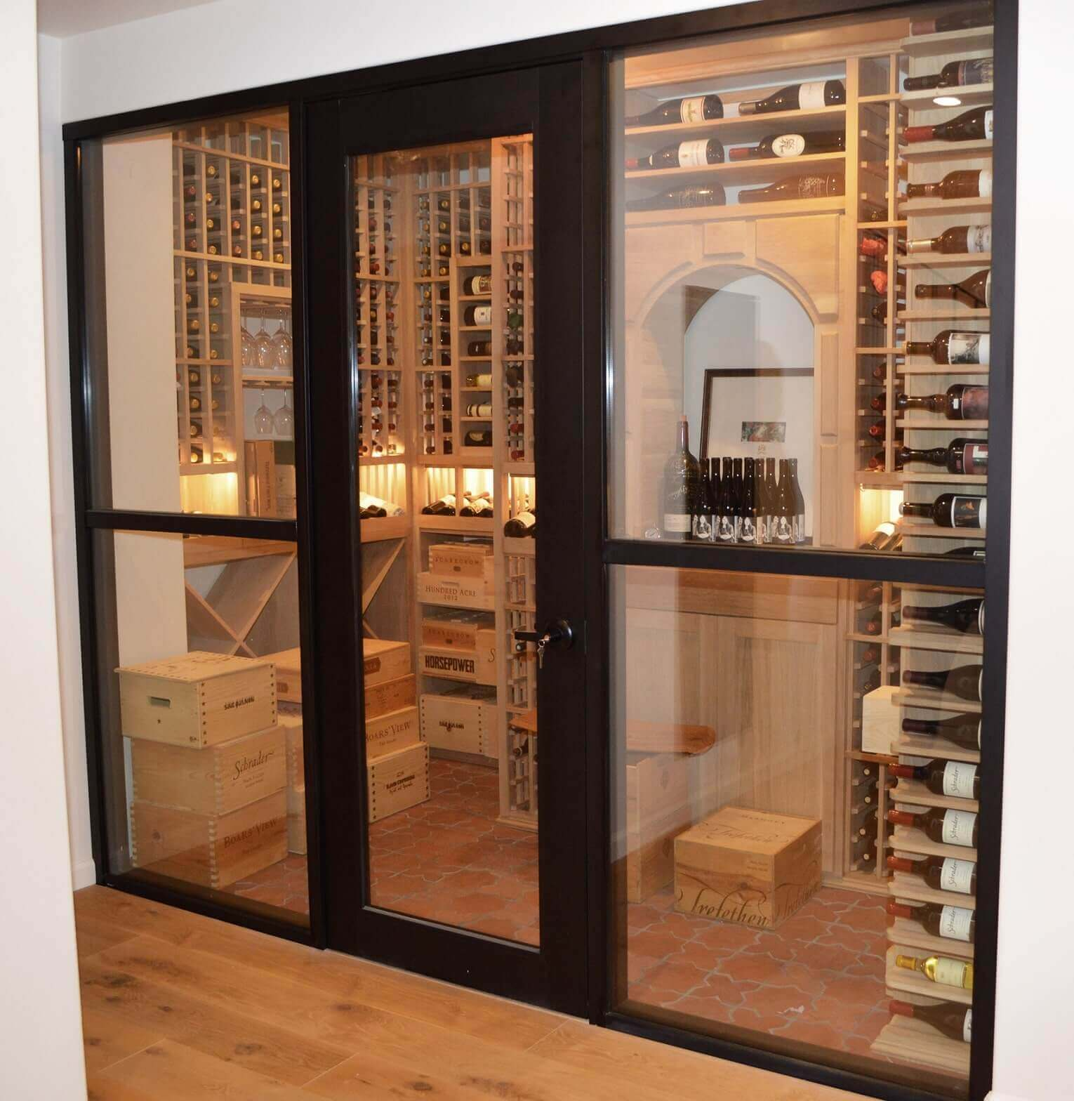 The wine cellar looks magnificent from the outside with the LED lighting turned on in the wine racking system.