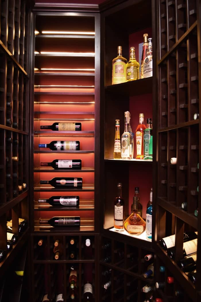The wine collection looks beautiful with the winecellar lighting turned on.