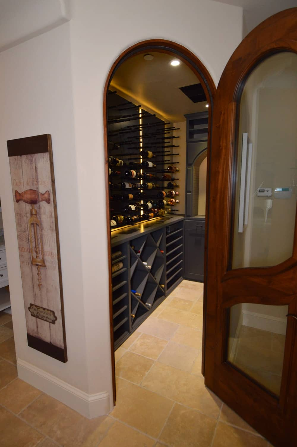 This door is equipped with a self-sealing mechanism. It helps in making ensure that there won't be any leaks or air gaps from the entrance of the wine cellar.