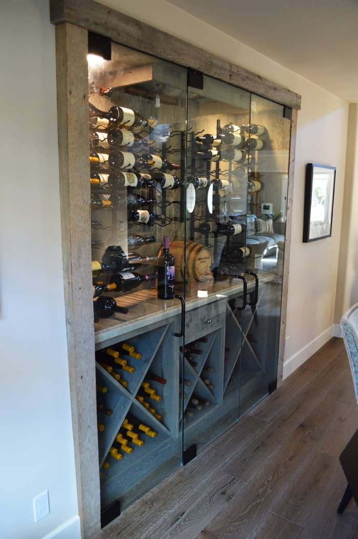 This wine cellar has both wooden and metal wine racks. It's like having the best of both worlds.